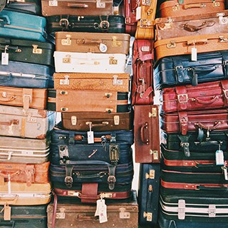 Stacked suitcases of various colors