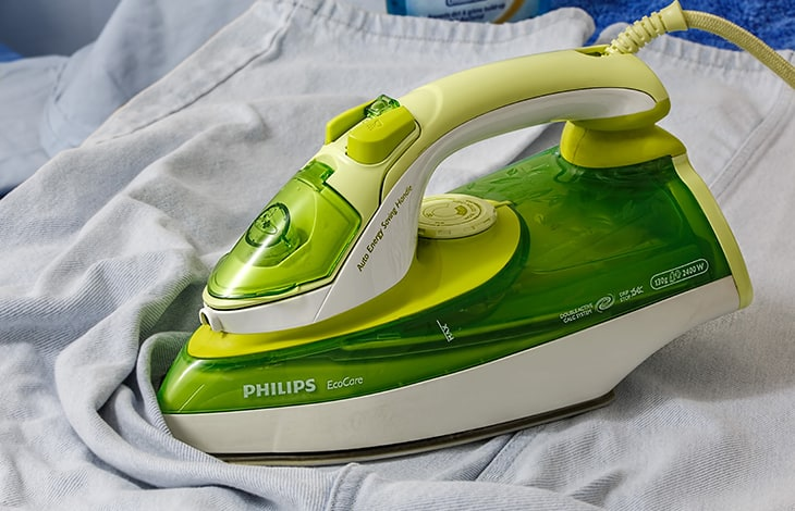 green clothes iron on jeans