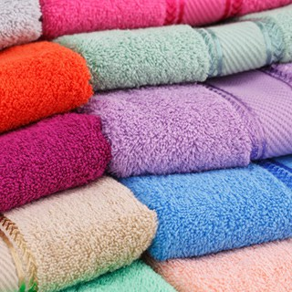 stacked folded towels of various colors