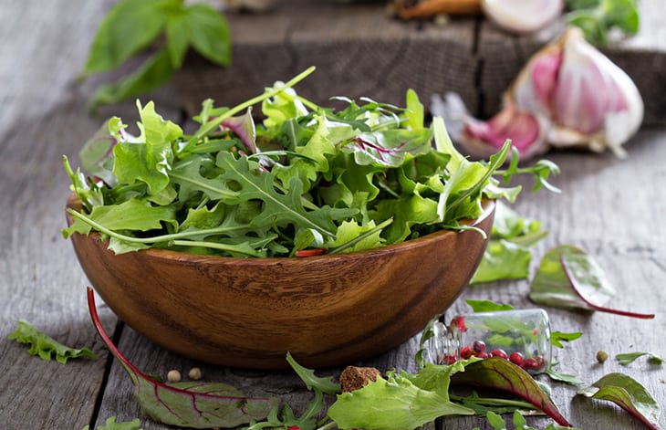 wooden bowl filled with salad greens