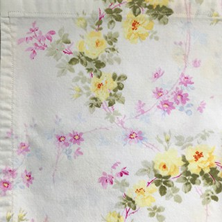 white cotton with yellow and pink flowers