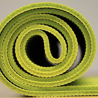 rolled green yoga mat