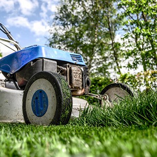 blue and gray lawn mower cutting grass