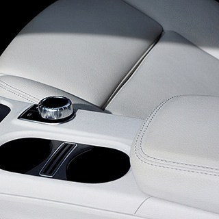 clean, white console and seat inside a car