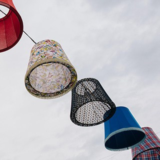lampshades hanging on a line
