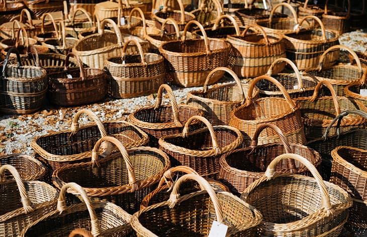 rows of wicker baskets with handles
