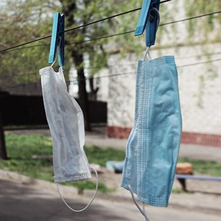 face masks hanging on a clothes line