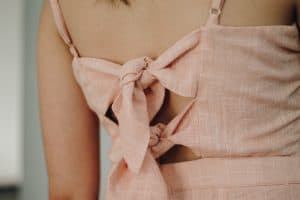 the back of a person wearing a peach-colored dress made of natural linen fiber