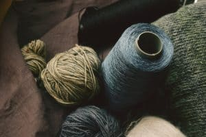 yarns and threads in natural green and blue hues