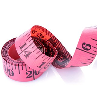 A coiled pink sewing tape measurer against a white background