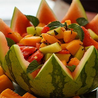 ripe melon salsa in a bowl made from a watermelon skin