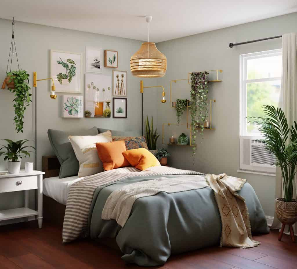green-gray, white, and orange bedding in a bedroom filled with natural light and houseplants