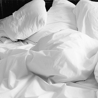 messy white bed sheets
