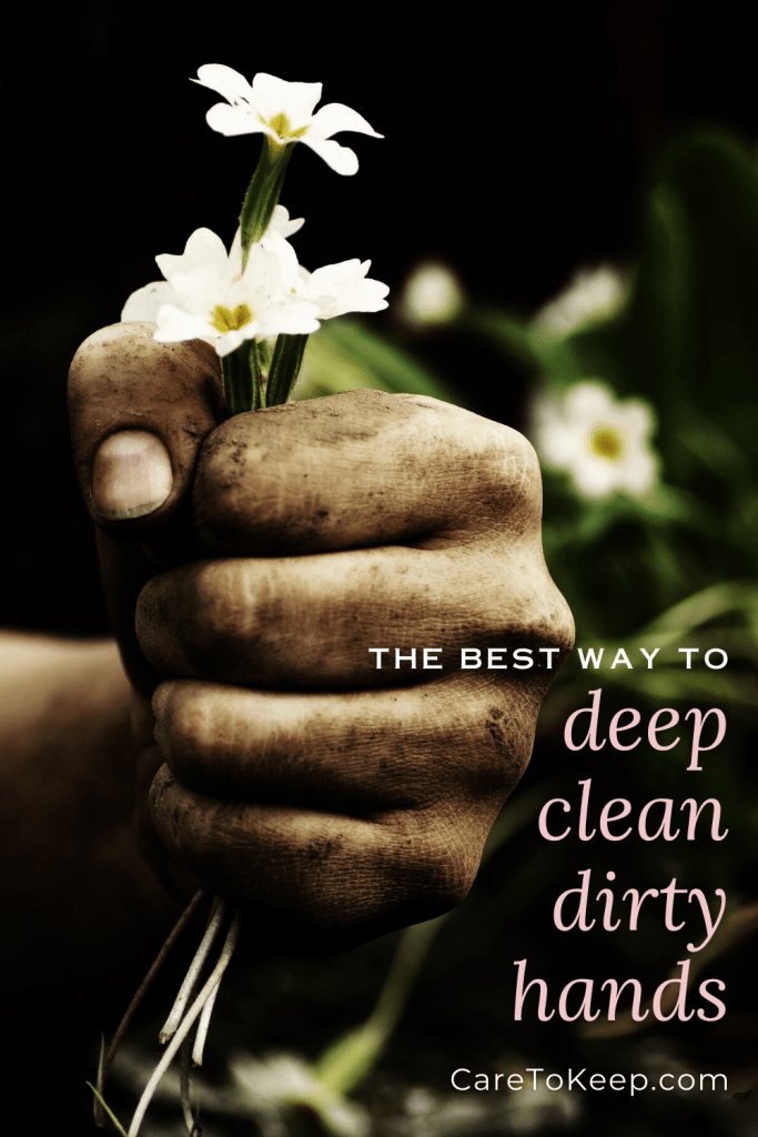 """a dirty fist holds white flowers against a dark background. White and light pink text over the image on the bottom right reads: """"The best way to deep clean dirty hands; CareToKeep.com"""""""